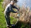 Dr. Whitford installing GooseBuster near lake